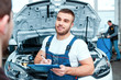 Car mechanic at the service station - 79050864