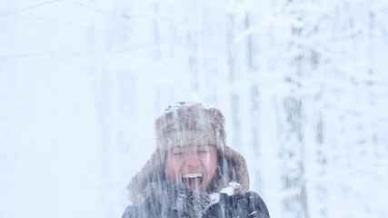 Young woman enjoying winter day outdoors, slow motion