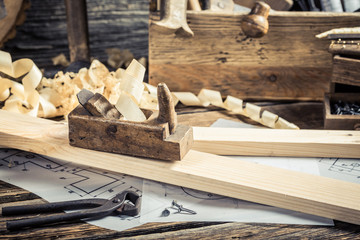 Diagrams and drafting tools in carpentry workshop