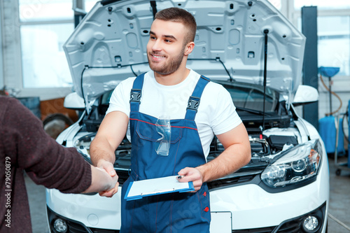 Car mechanic at the service station - 79050879