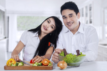 Healthy couple with fresh vegetables