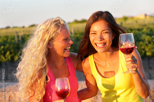 Happy friends drinking wine laughing - 79051822