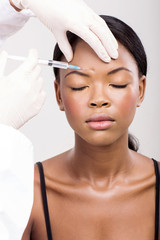 african woman receiving plastic surgery injection