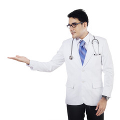 Male doctor with presentation hand gesture
