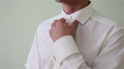 groom wears a tie