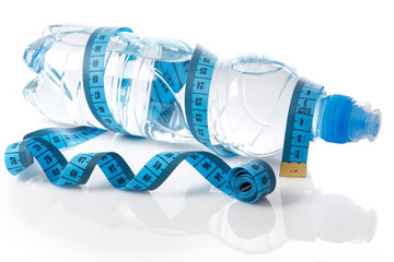 Bottle of water and measure tape