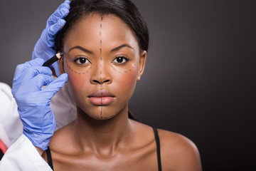 young african woman with correction mark