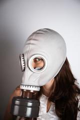 Woman wearing gas mask looking at camera