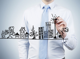 businessman drawing building