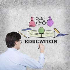 businessman drawing education symbol