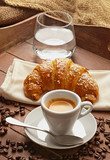 Fototapety Espresso with croissant and glass of water