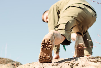 Shoe Sole of a Boy Scout Climbing a Rock