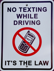 No texting while driving, its the law sign