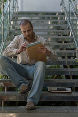 Businessman received envelope reading documents