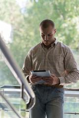 Business man holding a digital tablet