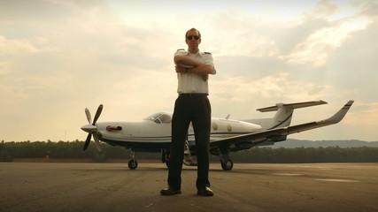 Proud Corporate Pilot Portrait with Jet Airplane