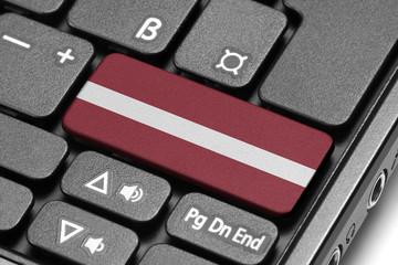 Go to Latvia! Computer keyboard with flag key.
