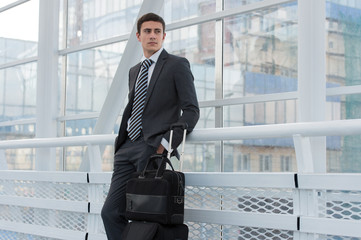 Businessman standing in urban environment of airport