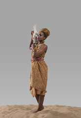Attractive young african woman carrying jug with water