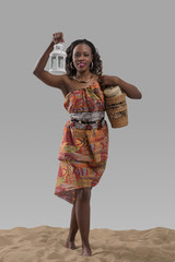 Attractive young african woman carrying basket with goods and la