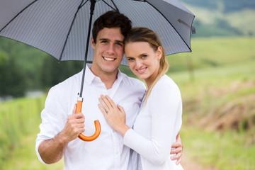 young couple under a umbrella