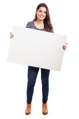 Cute girl with a white sign
