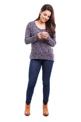 Cute girl texting with smartphone