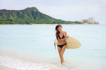 Surfer girl surfing walking with surfboard Waikiki