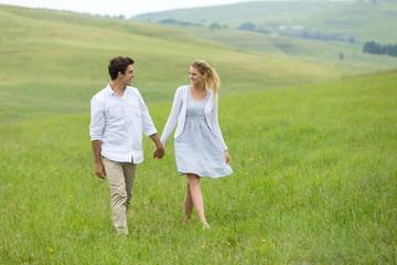 couple walking on countryside