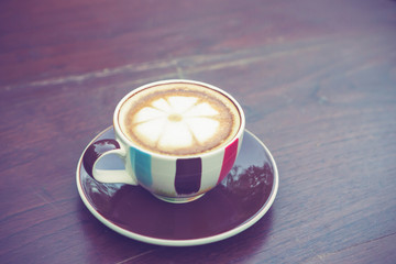 Coffee cup on table in cafe with vintage color tone