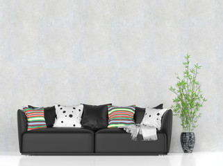 Black leather sofa with colorful pillows