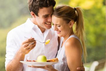 husband feeding wife breakfast