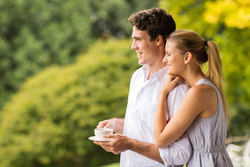 thoughtful young couple with cup of coffee