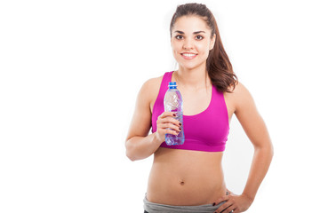 Pretty Latin girl drinking water