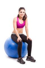 Pretty girl on an exercise ball