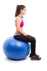 Sitting on a swiss ball