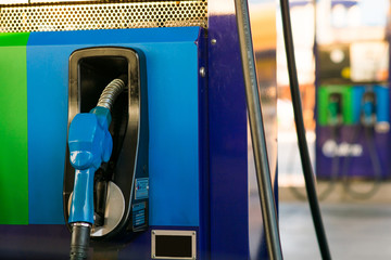 blue fuel oil dispenser at gas station