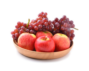 ripe red apples and grapes on white
