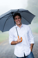 young man holding umbrella