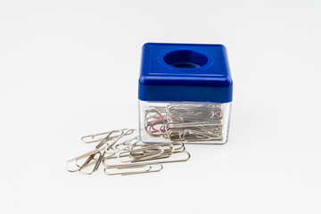 Paper clip box with on top a magnet to hold some paper clips