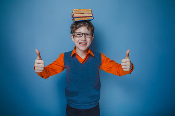 European-looking boy of ten years in glasses with books on her h