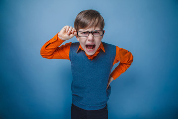 European-looking boy of ten years in glasses, anger, opened his