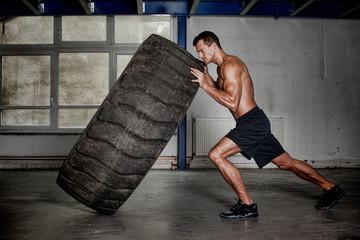 crossfit training - man flipping tire