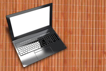 New modern laptop closeup on wooden abstract  background