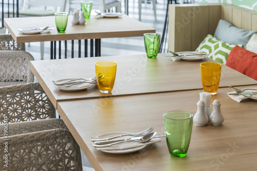 Tables set for meal in restaurant interior - 79063817