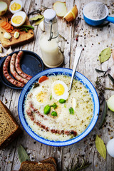 Traditional Polish sour cream soup with eggs and sausage
