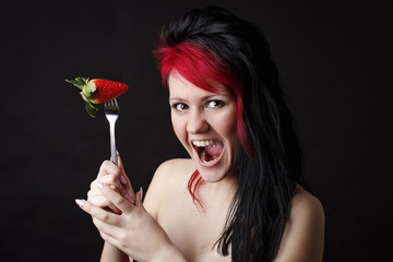 Crazy red hair woman with strawberry