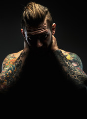 Portrait of male with tattoos.