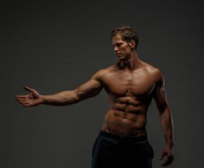 Portrait of handsome  man with naked torso.