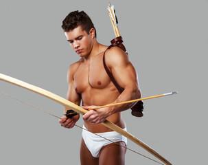 Muscular male in roman armor.